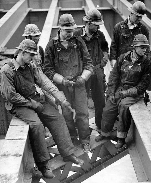 Workers taking a break on the bridge.