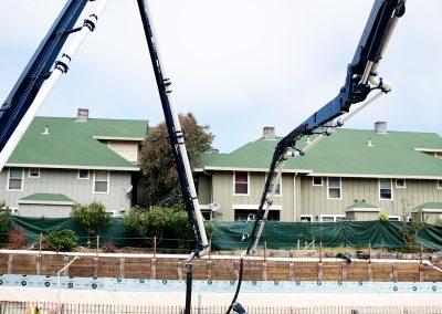 Two concrete pumps place concrete for a 34,246-square-foot mixed-use building in Santa Cruz, Calif.